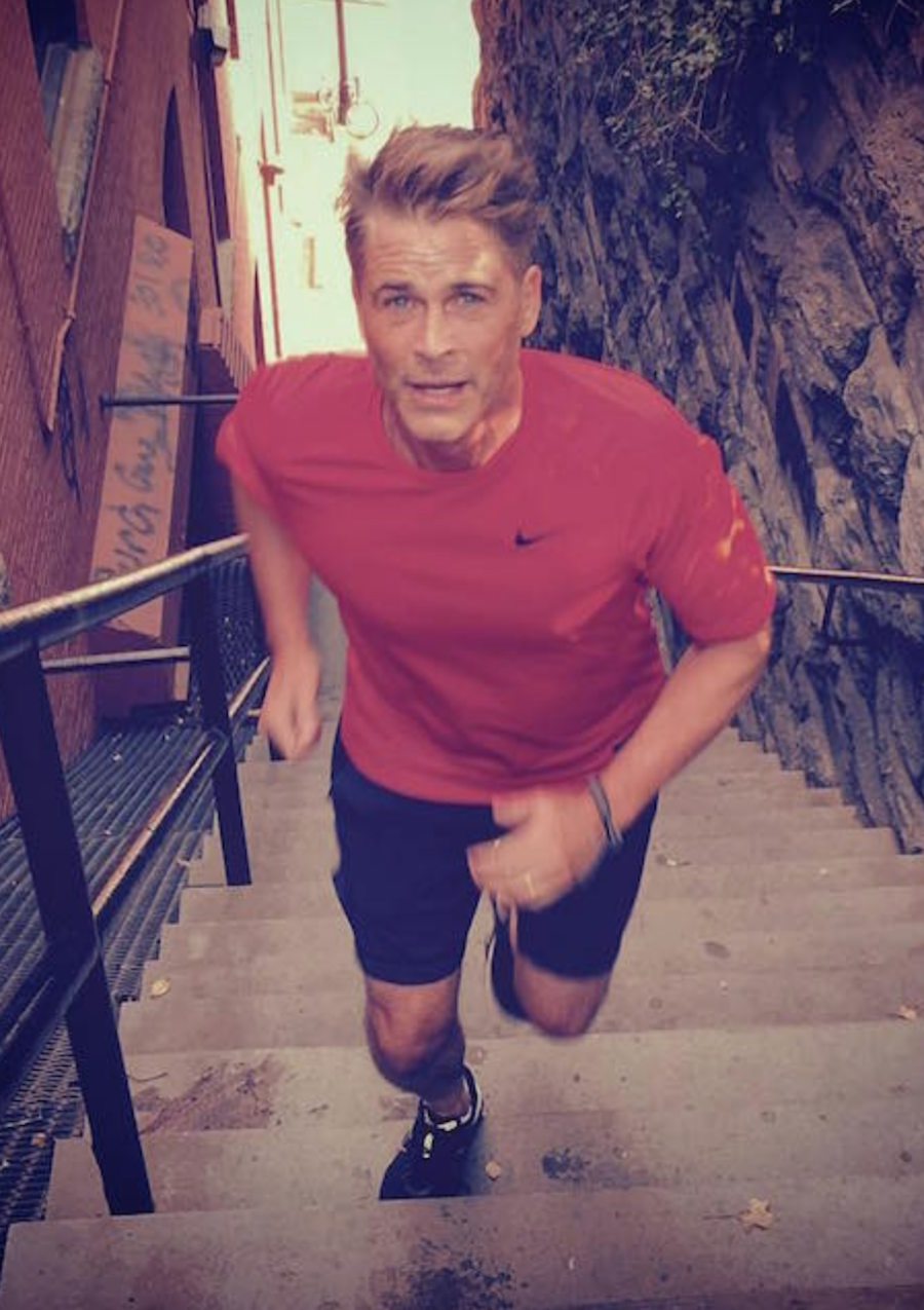 Actor Rob Lowe working out running stairs